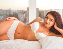 Girl on bed in underwear Royalty Free Stock Photography