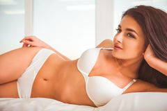 Girl on bed in underwear Royalty Free Stock Images