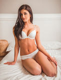 Girl on bed in underwear Royalty Free Stock Photos