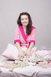 Girl in bed unexpectedly received an inheritance Stock Images