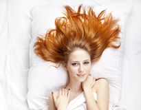 Girl in the bedroom. Stock Photo