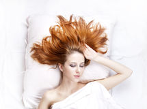 Girl in the bedroom. Stock Photography