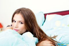 Girl in bedroom Stock Image