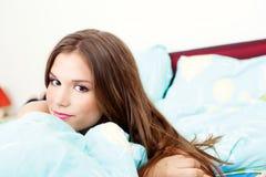 Girl in bedroom Stock Image