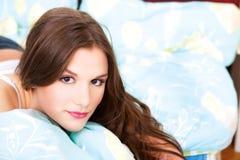 Girl in bedroom Stock Images