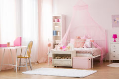 Girl bedroom with canopy bed Royalty Free Stock Photos