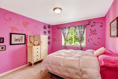 Girl bedroom interior in bright pink color Royalty Free Stock Photo