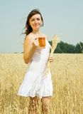 Girl  with beer at field Royalty Free Stock Image