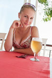 Girl with beer in a restaurant Royalty Free Stock Photo