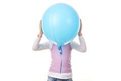 Girl behind ballon Stock Images