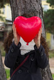 Girl behind the balloon heart Royalty Free Stock Image