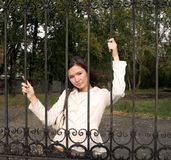 Girl behind bars Stock Photography