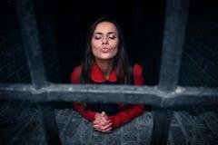 Girl behind bars Stock Photos