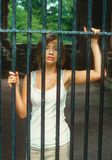 Sexy teen behind bars Stock Photo