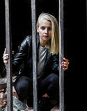 Girl behind bars Stock Images