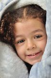 Girl Behind Blanket. Smiling Playful Gril Covered By Warm Blanket Royalty Free Stock Photography