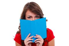 Girl behind colorful book Stock Photo