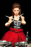 Girl behind drum-type installation Stock Image