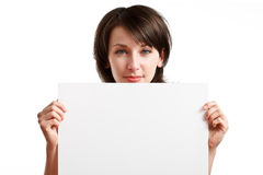 Girl behind empty board Stock Images