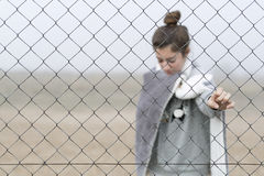 Girl behind a fence. Stock Image