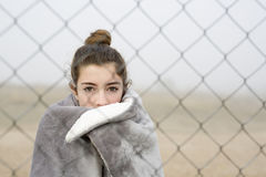 Girl behind a fence. Stock Photo