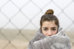 Girl behind a fence. Stock Photography