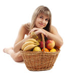 Girl behind fruit basket Stock Photos