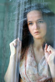 The girl behind glass Stock Photo