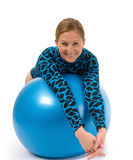 Girl behind gym ball Stock Images