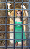 Girl behind iron bars Stock Image