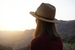 Girl from behind looking at the mountains Stock Image
