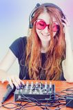 Girl behind the music console Stock Image