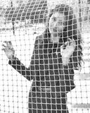 Girl behind the net Stock Images