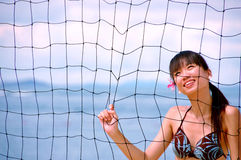 Girl behind net Stock Photos