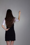 Girl from behind shows something Stock Photos