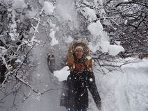 A girl walks into a snow-covered Park royalty free stock images