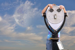 Girl behind telescope Stock Image