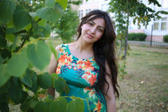 Girl behind the tree. Beautiful caucasian woman staying behind the tree Royalty Free Stock Photo