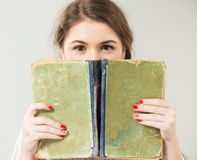 Girl behind vintage book Royalty Free Stock Photo