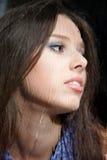 Girl behind wet window Stock Image