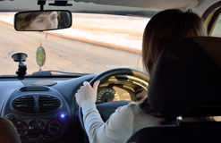 The girl behind the wheel of a car Royalty Free Stock Photography