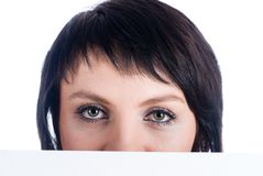 Girl behind white board Royalty Free Stock Photography