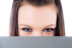 Girl behind white board Royalty Free Stock Images