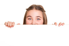 Girl behind a white board Stock Photography