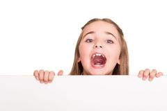 Girl behind a white board Stock Photo