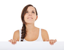 Girl behind white wall Stock Photography