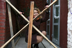 A girl behind wooden barriers Stock Images