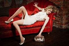 Girl in a beige dress Stock Images