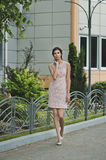 The girl in a beige dress on walk 3364. Stock Photo