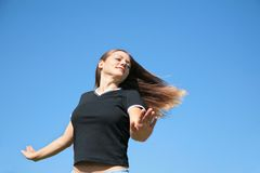Girl with being fluttered hair on sky Stock Image